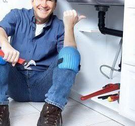 plumber unblocking a sink